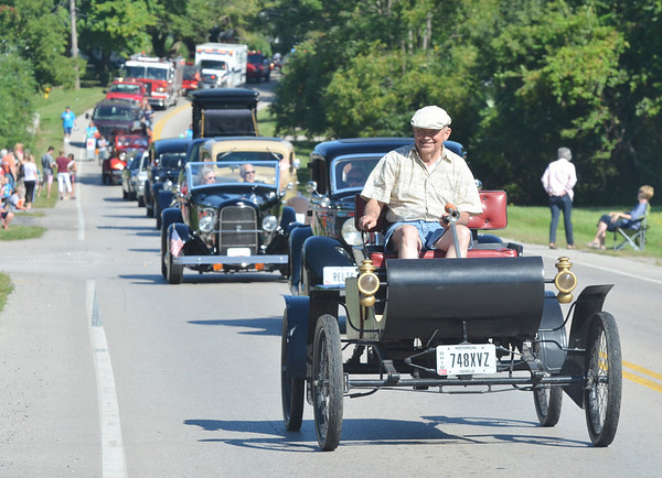 WARREN DILLAWAY / Star Beacon<br /> ANTIQUE CARS and a variety of units made up the North Kingsville Centennial Parade on Saturday morning along Route 193.