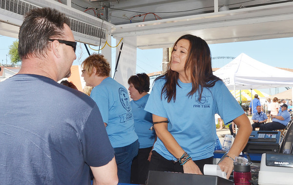 WARREN DILLAWAY / Star Beacon<br /> DARLENE CASTO of American Family Concessions sells tickets for fish dinners at the Wine and Walley Festival in Ashtabula Harbor on Saturday.