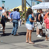 WARREN DILLAWAY / Star Beacon<br /> PEOPLE WAIT to buy tickets for fish dinners on Saturday during the Wine and Walleye Festival in Ashtabula Harbor.