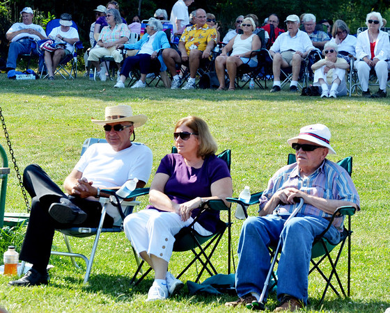 WARREN DILLAWAY / Star Beacon<br /> A SMALL group of music fans chose to stay in the sun while the majority moved to the shade at Walnut Beach on Sunday afternoon during a Bands on the Beach performance.