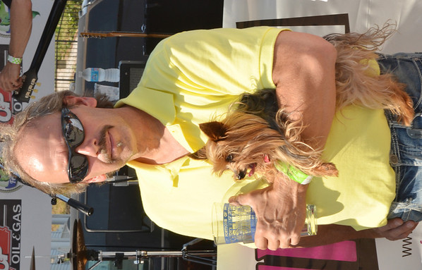 WARREN DILLAWAY / Star Beacon<br /> GARY BAUER, of Brookfield, and his dog Calvin wait for the Wine and Walleye Festival boat parade winners to be announced on Saturday in Ashtabula Harbor.