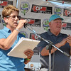WARREN DILLAWAY / Star Beacon<br /> JULIE HUNT of the Wine and Walley Festival annouces the winners of the boat parade with festival fish commissioner Joe Misinec on Sunday at the festival in Ashtabula Harbor.