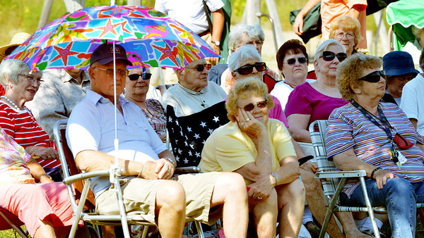 WARREN DILLAWAY / Star Beacon<br /> MUSIC FANS try to stay cool during Bands on the Beach on Sunday afternoon at Walnut Beach in Ashtabula.