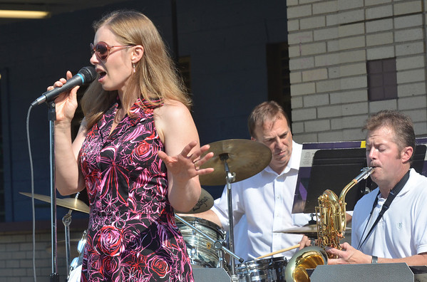 WARREN DILLAWAY / Star Beacon<br /> BETH JOHNSON sings with Tony Esposito's All Star Big Band on Sunday afternoon during Bands at the Beach at Walnut Beach in Ashtabula.