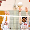 WARREN DILLAWAY / Star Beacon<br /> COURTNEY ENSELL (left) and Edgewood teammate Iesha Niciu leap for a block during a home match with Fairport on Monday evening.