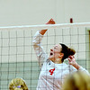 WARREN DILLAWAY / Star Beacon<br /> ALYSSA JOHNSON of Edgewood leaps for the ball on Monday during a home match with Fairport.