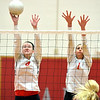 WARREN DILLAWAY / Star Beacon<br /> ALYSSA JOHNSON (left) and Karli Kanicki, both of Edgewood, leap for a block during a home match with Fairport on Monday evening.