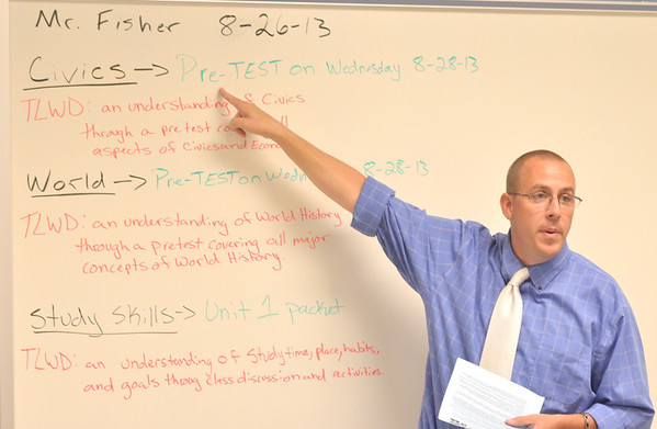 WARREN DILLAWAY / Star Beacon<br /> KURTIS FISHER teaches Civics during the first day of school at Grand Valley High School on Monday.