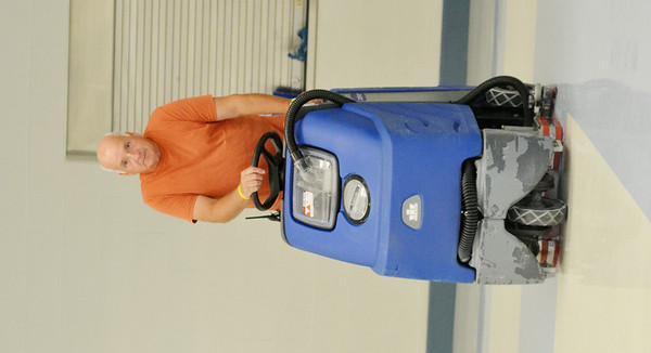 WARREN DILLAWAY / Star Beacon<br /> ED BENTON, a custodian at Grand Valley Elementary School, uses a machine to clean the floor during the first day of school.