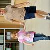 WARREN DILLAWAY / Star Beacon<br /> DOUG BAILES picks up his daughter Alyssa Bailes after the first day of school at Geneva Platt R. Spencer Elementary School on Monday.
