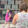 WARREN DILLAWAY / Star Beacon<br /> AMBER THOMAS (right) takes a picture of her second grade daughter Morgan Campbell-Thomas after the first day of school at Geneva Platt R. Spencer Elementary School on Monday.