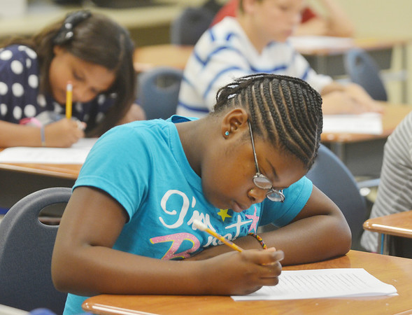 WARREN DILLAWAY / Star Beacon<br /> AMYA COTTRELL, a sixth grade student at Erie Primary School, gets down to work on Tuesday during the first day of school in the Ashtabula Area School District.