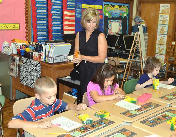WARREN DILLAWAY / Star Beacon<br /> TERRI SANTEE, a first grade teacher at Kingsville Elementary School, keeps an eye on her students during the first day of class.