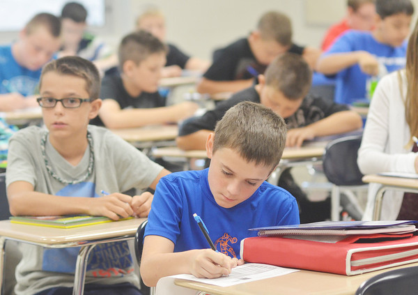 WARREN DILLAWAY / Star Beacon<br /> LOGAN POORE (foreground) and Logan Mucci (left) listen to instructions during a study hall at Conneaut Middle School on Tuesday.