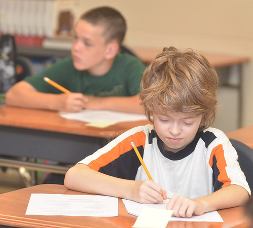 WARREN DILLAWAY / Star Beacon<br /> JOSEPH LASKO, a sixth grade student at Erie Primary School, gets down to work on Tuesday during the first day of school in the Ashtabula Area School District.