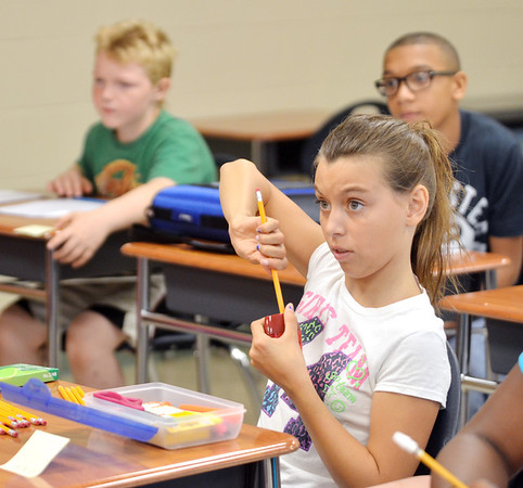 WARREN DILLAWAY / Star Beacon<br /> AMBER CORLIS, a sixth grade student at Erie Primary School, sharpens a pencil on Tuesday during the first day of school in the Ashtabula Area School District.