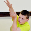 WARREN DILLAWAY / Star Beacon<br /> BRANDON VIDMAR, a sixth grade student at Kingsville Elementary School, raises his hand to ask a question during the first day of school on Tuesday.