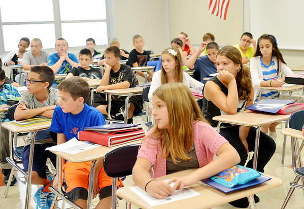WARREN DILLAWAY / Star Beacon<br /> SHAKIRA DALRYMPLE and her seventh grade classmates listen to instructions during a study hall at Conneaut Middle School on Tuesday.