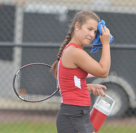 WARREN DILLAWAY / Star Beacon<br /> MAKALA FIORITTO of Jefferson wipes her brow during a break in the action of a third singles match with Lakeside.