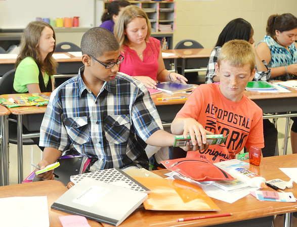 WRREN DILLAWAY / Star Beacon<br /> DRESHON LUCAS (left) and Brent Loveland get their desks ready for work during the first day of school at Erie Primary School in Ashtabula on Tuesday morning.
