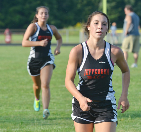 WARREN DILLAWAY / Star Beacon<br /> DEANNA COMP and Jefferson teammate Jessie Stranman sprint to the finish line of the Pymatuning Valley Invtational on Thursday in Andover Township.