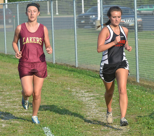 WARREN DILLAWAY / Star Beacon<br /> COLLEEN O'CONNOR of Jefferson and Sadie Lappe (left) of Pymatuning Valley compete in the Pymatuning Invitational on Thursday in Andover Township.