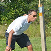 WARREN DILLAWAY / Star Beacon<br /> STEVE LOCY, Jefferson cross country coach, cheers on his Falcons on Thursday during the Pymatuning Valley Invitational.