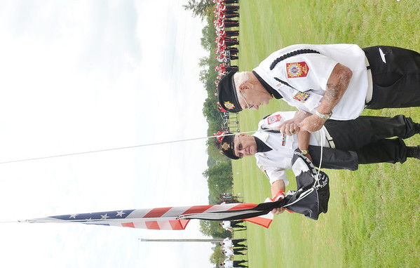 WARREN DILLAWAY / Star Beacon<br /> DANNY PASQUALONE (left) and fellow Veterans of Foreign Wars Lodge 6846 Geneva member Dan Micco prepare to raise the flag to open the Wounded Warrior Golf Tournament on Friday afternoon at Hemlock Springs Golf Course in Harpersfield Township.