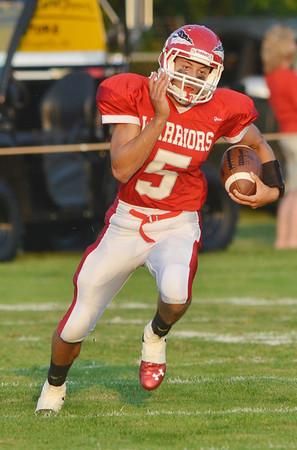 WARREN DILLAWAY / Star Beacon<br /> RIIS SMITH of Edgewood tries to find running room during a home game on Friday night with Geneva.