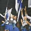 WARREN DILLAWAY / Star Beacon<br /> HOLLY NYE (far right) and Tylor Whitely (second from right) reach for their flags during a Grand Valley band performance on Friday night in Orwell.