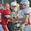 WARREN DILLAWAY / Star Beacon<br /> ANTHONIE MAGDA (18) of Edgewood shakes hands with Geneva players prior to a home game with Geneva on Friday night.