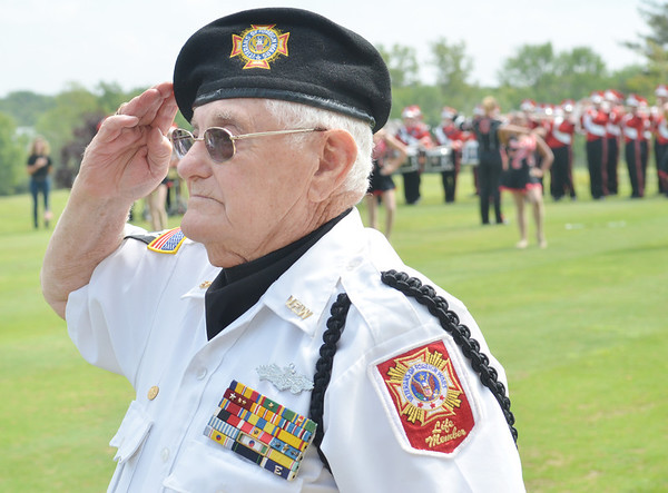 WARREN DILLAWAY / Star Beacon<br /> DAN MICCO of the Veterans of Foreign Wars Lodge 6846 salutes the flag as the National Anthem is played to open the Wounded Warrior Golf Tournament on Friday afternoon at Hemlock Springs Golf Course in Harpersfield Township.