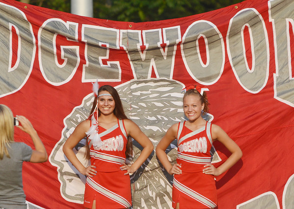 WARREN DILLAWAY / Star Beacon<br /> KAYLA PERRY (left) and Hannah Coon, both Edgewood cheerleaders, pose for pictures on Friday night prior  to a home football game with Geneva.
