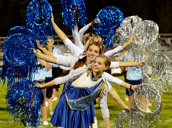 WARREN DILLAWAY / Star Beacon<br /> TYLOR WHITELY (front) and Callie Forrest (second) perform on Friday night with the Grand Valley band at halftime of a home game with Conneaut.