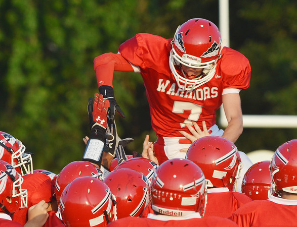 WARREN DILLAWAY / Star Beacon<br /> SHAWN HODGE (7) of Edgewood leaps on top of teammates prior to  the start of a home game with Geneva on Friday night at Corlew Stadium.