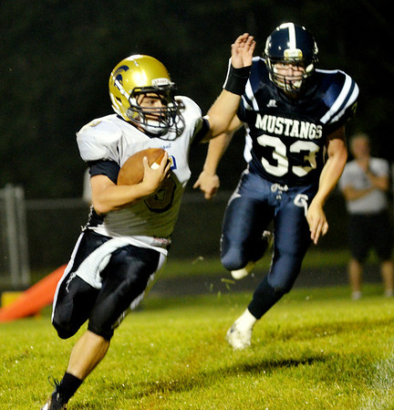 WARREN DILLAWAY / Star Beacon<br /> TROY COLUCCI of Connneaut runs for a touchdown as Tyler Zsigray of Grand Valley follows the play on Friday night in Orwell.