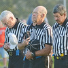 WARREN DILLAWAY / Star Beacon<br /> REFEREES JOIN in a moment of silence for Jackie Hillyer, Buckeye school board president that recently died during a trip to Africa, prior to the Edgewood Geneva football game at Corlew Stadium on Friday night.