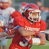 WARREN DILLAWAY / Star Beacon<br /> ANTHONY BARGER of Edgewood tries to find running room during a home game on Friday night with Geneva.