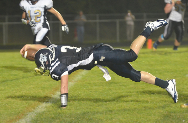WARREN DILLAWAY / Star Beacon<br /> JAKE VORMELKER, Grand Valley quarterback leans across the goal line for a touchdown on Friday night during a home game with Conneaut.