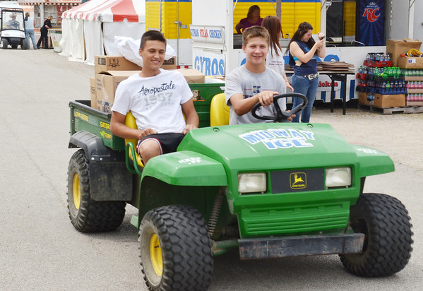 WARREN DILLAWAY / sTa rBeacon<br /> DYLER DEMPSEY, 14, (left) of Bristol and  Stevve Burbach Jr., 14, of West Farmington, deliver supplies ot concessions on Monday during preparation for the Ashtabula County Fair in Jefferson.