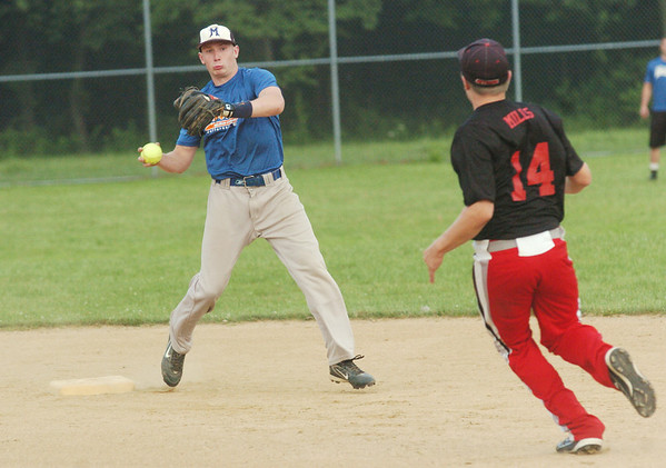 WARREN DILLAWAY / Star Beacon<br /> JOSH SHORTS of Brian's Auto Repair attempts to turn a double play over Tyler Mills of Meade's Auto on Monday night at Massucci Field in Ashtabula.