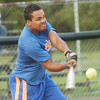 WARREN DILLAWAY / Star Beacon<br /> DERRELL MCCALEB of Brian's Auto Repair hits the ball on Monday during Ashtabula Recreation League Softball action at Massucci Field.