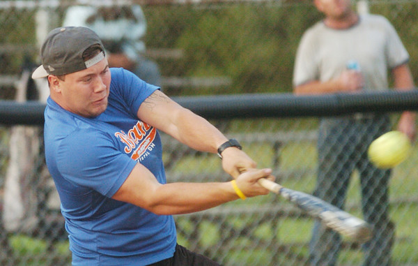 WARREN DILLAWAY / Star Beacon<br /> KYLE GEORGE of Brian's Auto Repair takes a mighty swing during Ashtabula Recreation League Softball action at Massucci Field in Ashtabula.
