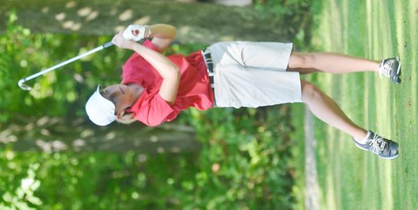 WARREN DILLAWAY / Star Beacon<br /> DANIELLE NICHOLSON of Geneva follows through on a swing on Tuesday during the Karl Pearson Invitational at Maple Ridge Golf Course in Saybrook Township .