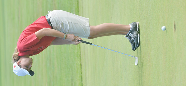WARREN DILLAWAY / Star Beacon<br /> DANIELLE NICHOLSON of Geneva chooses a club on Tuesday during the Karl Pearson Invitational at Maple Ridge Golf Course in Saybrook Township.