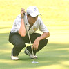 WARREN DILLAWAY / Star Beacon<br /> BRIAN IRISH of Riverside sets up a putt on Tuesday during the Karl Pearson Invitational at Maple Ridge Golf Course in Saybrook Township .