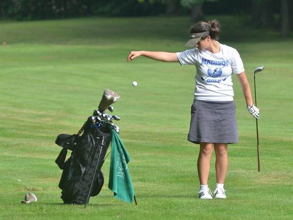 WARREN DILLAWAY / Star Beacon<br /> KASIE BERIS of Madison takes a drop  on Tuesday during the Karl Pearson Invitational at Maple Ridge Golf Course in Saybrook Township.