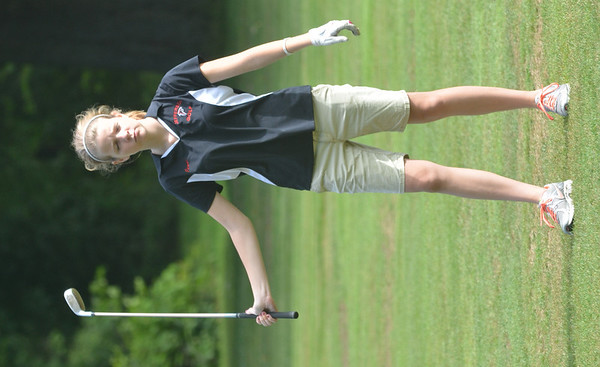 WARREN DILLAWAY / Star Beacon<br /> JENNI TOMS of Jefferson complets a swing on Tuesday during the Karl Pearson Invitational at Maple Ridge Golf Course in Saybrook Township .