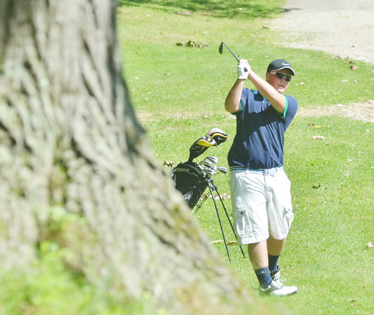 WARREN DILLAWAY / Star Beacon<br /> BEN MIDDLESTAT of Connaut follows through on a shot on Tuesday during the Karl Pearson Invitational at Maple Ridge Golf Course in Saybrook Township .