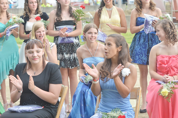 WARREN DILLAWAY / Star Beacon<br /> ELLEN DARBY, 18, of Jefferson (middle row center) was crowned the Ashtabula County Fair Queen on Tuesday night at the fairgrounds in Jefferson as other candicates react in the foreground.